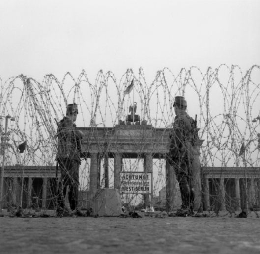 Barbed-wire barricades/Berlin Wall/1961  The Berlin Wall. (Building began on 13 August 1961). - Barbed-wire barricades are erected near the Brandenburg Gate, 14-15 August 1961. - Photo (Gert Schuetz).